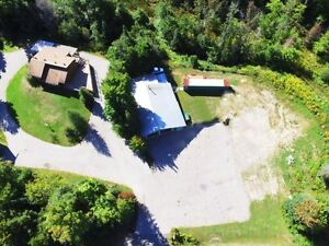 Incredible Opportunity! Shop on 19 Acres with income property!