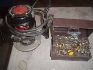 router and bit set / air hose on reel