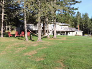 Beautiful acreage in NB.  Newer house, river view & huge garage