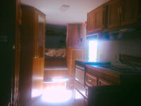 23ft Rustler fifth wheel travel trailer in excellent condition.