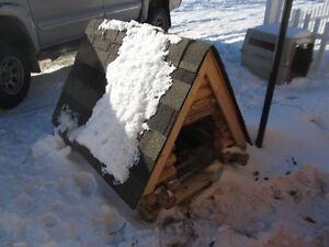 Large very sturdy and heavy log Dog House