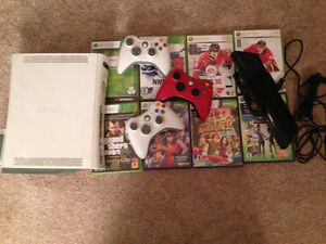 Xbox 360 including a Kinect, 3 controllers and and 8 games