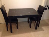 Black marble table and chairs