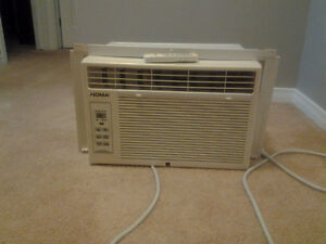 Window air conditioner with remote, timer.