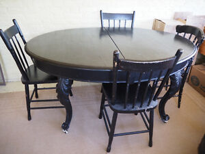 Antique Oval Butternut Table with 4 chairs.
