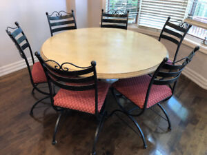 Distressed Wood Table with Wrought Iron Base and Chairs