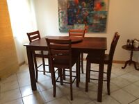 Solid wood pub table with 8 chairs