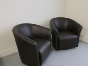 2 brown swivel PU leather tub chairs