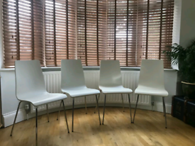 Contemporary wooden and chrome dining chairs