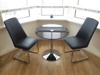 Dfs black glass table and 2 chairs
