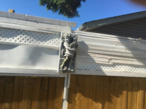 Outside angel with grapes.  3D on plaque