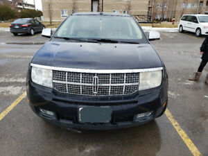 2008 metallic blue Lincoln MKX