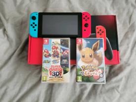 Nintendo Switch + Pokemon Let's Go Eevee & Super Mario All Stars