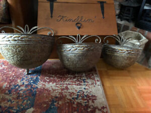 Set of 3 rustic metal wall planters.