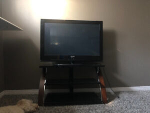 """42"""" Samsung TV and stand"""