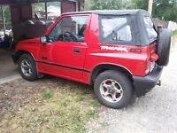 1997 Geo Tracker Convertible, Red w/ black & chrome trim