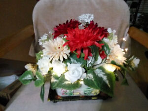 Beautiful centrepiece made of quality silk flowers with LEDs