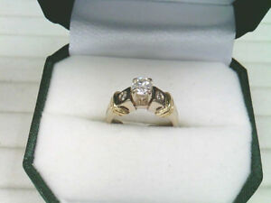 One Lady's 14k White and Yellow Gold, Diamond Ring.