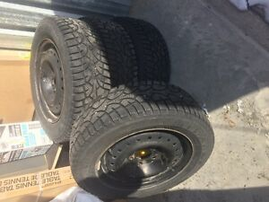 Winter tires on rims with great tread.  195/65R15