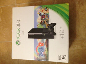 Xbox 360 with 3 games and 3 controllers