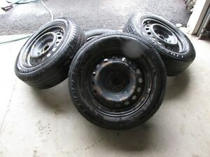 """15"""" Corolla rims and tires 185 65 15"""