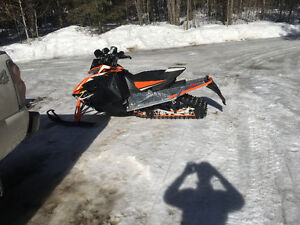 Willing to trade for low km arctic cat 8000 137