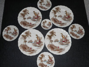 The Old Mill  8 piece plate setting made in England  $10