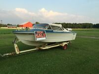 16 foot boat. 85 Evinrude New price