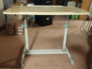 Drafting table, clothing rack, folding chairs for sale