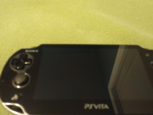 PS Vita with games, memory cards and cases for $200 obo
