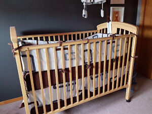 Matching crib, mattress, change table, linens and mobile