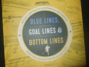 blue lines,goal lines and bottom lines by greg oliver