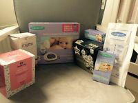 Brand new Lansinoh breast pump and accessories