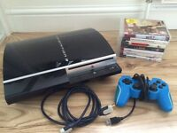 PlayStation 3 with controller and leads + 7 games