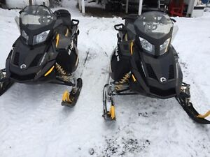 Pair of skidoo snowmobiles