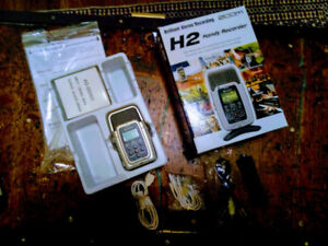 Zoom H2 digital audio recorder with accessories