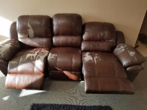 Leather Electric Reclining Couch. Moving sale . Need go ASAP