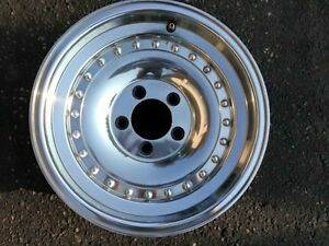 "wanted 2-  15""x10"" or wider american racing  outlaw 1   rims"