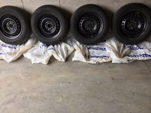 Winter tires Michelin X-Ice on steel rims $600 OBO