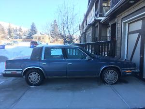 1990 Chrysler New Yorker blue Sedan