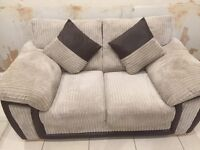 DFS two, two seaters only 6mths old in perfect condition, beige & brown cloth