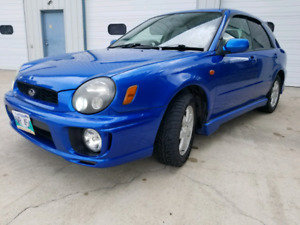 Safetied 2002 Subaru Impreza RHD with Winter tires