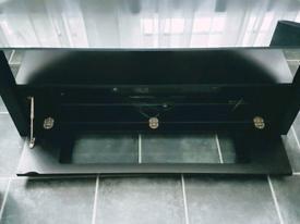 Stylish, black glass top TV unit