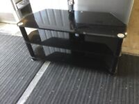 Glossy black glass tv stand with shelf
