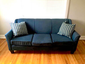 Sturdy, solid 3 seater sofa.