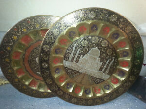 Decorative brass wall plates (4) and  2  small wall mirrors