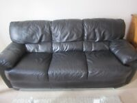 Three seater & matching two seater black leather sofas