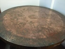 Round table with copper plate on the top
