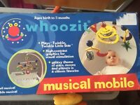 Whoozit musical mobile by Manhattan Toy Company