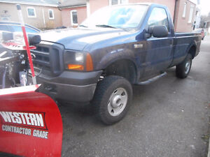 Ford F-250 Pickup Truck with Western V Blade